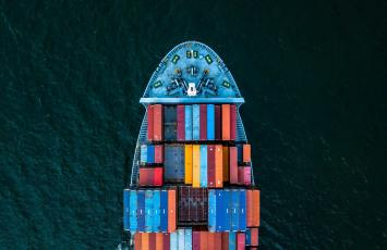 Drone picture of ship with colorfull cargo